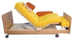 INDREA Aufsteh- und Pflegebett in Lesepostion zur Entspannung